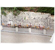 Outdoors tables and colored chair in Montmartre Paris Poster