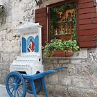 Street scene in Trogir by Elena Skvortsova