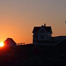 Nubble Light Sunrise by Linda  Makiej