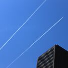 Jets crisscrossing in the downtown Chicago Sky by Adam Kuehl