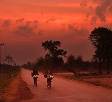 Sunrise on Two Wheels - Champasak, Laos by Alex Zuccarelli