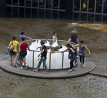 People walking around the Fountain of Wealth in Singapore by ashishagarwal74