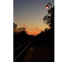 The Sun setting on Lisle, IL train tracks leaving the station. Photographic Print