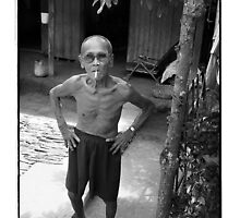 Local man Mekong Delta Vietnam by Malcolm Heberle