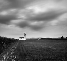 Storm clouds gather over church by Ian Middleton
