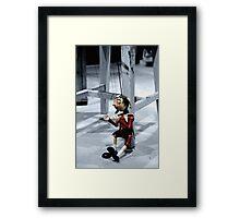 Marionette Framed Print
