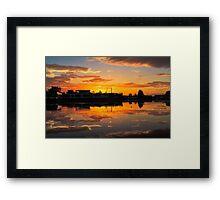 Sunrise arcross the water Framed Print
