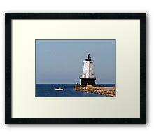 Ludington Light and Fishermen Framed Print