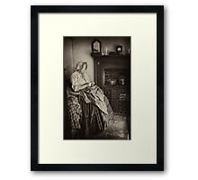 Darning by the fire Framed Print