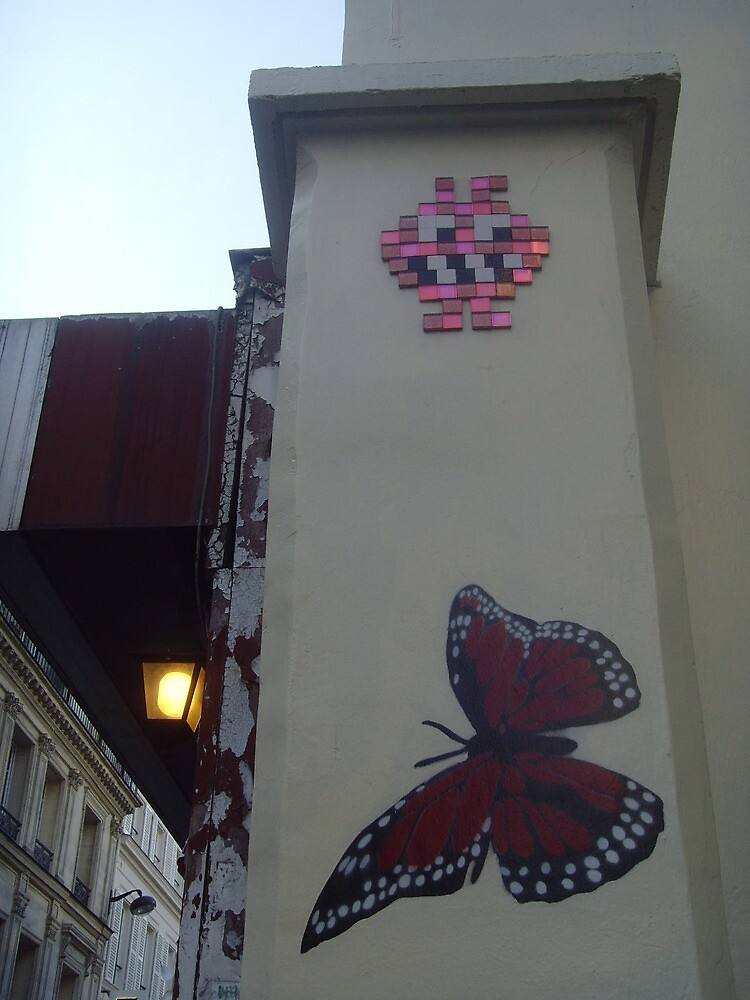 Butterfly and space invader by Caroline Clarkson