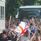 The Olympic Torch in High Street Kenilworth. by John Evans