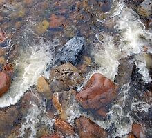 River rocks and rushing water by DanByTheSea