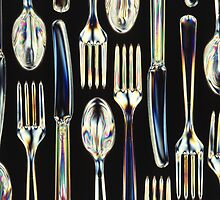 Plastic Knives, Forks and Spoons Arranged In A Pattern by taiche