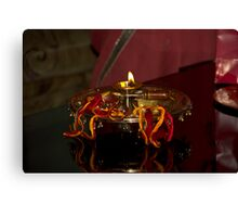 Lamp on a metal plate as part of a Hindu ritual Canvas Print