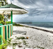 Colourful kiosk and gathering storm clouds. by brians101