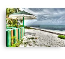 Colourful kiosk and gathering storm clouds. Canvas Print