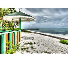 Colourful kiosk and gathering storm clouds. Photographic Print