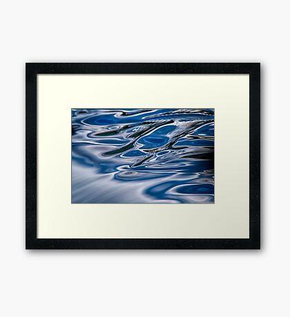 A river flows Framed Print