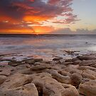 Sunrise and Rocks by Phillip  Simmons