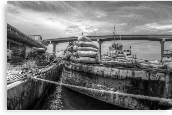Unloading bags of coal in Potter's Cay - Nassau, The Bahamas by Jeremy Lavender Photography