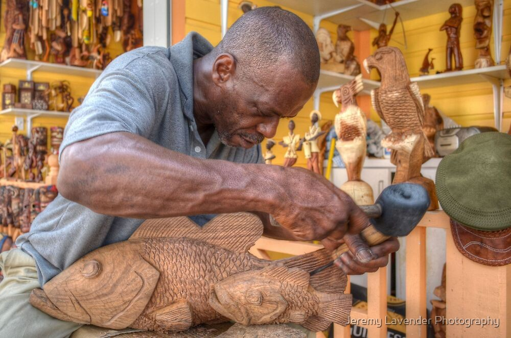 Bahamian Sculptor carving the Wood at the Straw Market in Nassau by Jeremy Lavender Photography