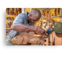 Bahamian Sculptor carving the Wood at the Straw Market in Nassau Canvas Print