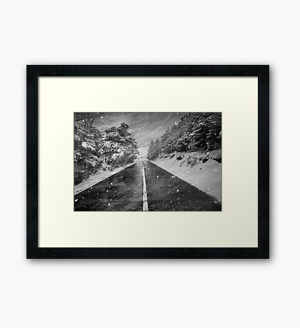 Snowstorm in the road Framed Print