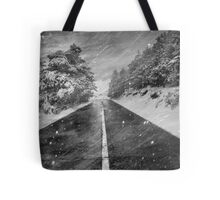 Snowstorm in the road Tote Bag