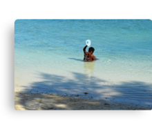 Bahamian woman taking a morning bath in the ocean Canvas Print