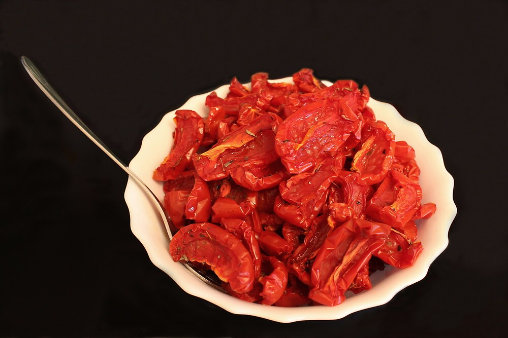 Sun-dried tomatoes on a plate by mrivserg