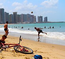 Football on the Beach by oftheessence