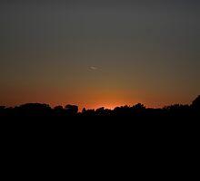 Sunset contrail by Jstarnes