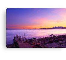 Sunset along the coast under long exposure Canvas Print