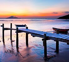 Sunset coast at wooden pier by kawing921