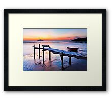 Sunset coast at wooden pier Framed Print