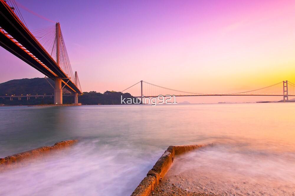 Hong Kong bridges at sunset over the ocean by kawing921