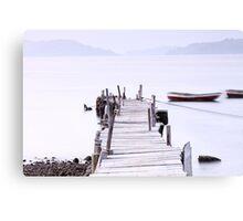 Sunset pier under long exposure, high key image. Canvas Print