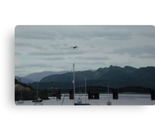 Hercules plane flying over Barmouth Canvas Print