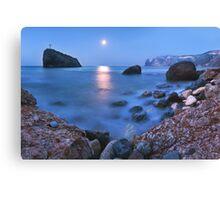 Coast rock with cross on moonrise Canvas Print