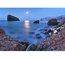 Coast rock with cross on moonrise Photographic Print