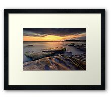 Sunset at the rocky beach Framed Print