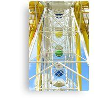 Ferris wheel against a blue sky  Canvas Print