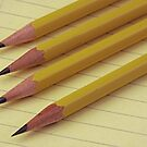 Four Pencils on Yellow Legal Pad by Robert Armendariz