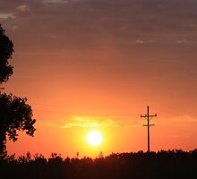 Kansas Blazing Orange Silhouette Sunset by ROBERTDBROZEK
