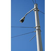 A streetlight and clear, blue sky Photographic Print