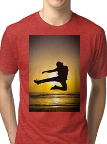 Martial arts silhouette at sunset Tri-blend T-Shirt