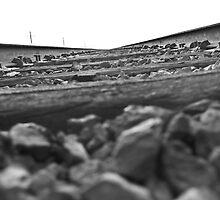 B&W between the rail by fireangelsphoto