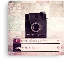 Retro - Vintage Black Camera on Beige Background and books  Canvas Print