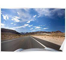 Car travelling fast along tarmac road, USA Poster