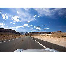 Car travelling fast along tarmac road, USA Photographic Print
